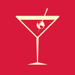 Cocktail glass garnished with the Earth, on red