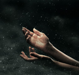 Female hands on stormy sky