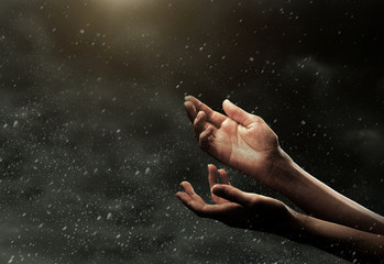 Female hands on cloudy sky