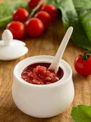 Horseradish sauce with tomatoes.