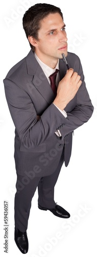 Thinking businessman holding pen