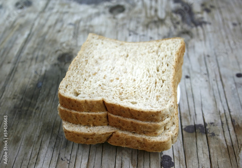 wheat bread on wooden