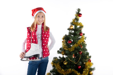 Girl with skates in christmas tree