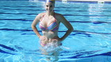 Woman doing gimnastic in water