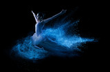 Fototapety Young beautiful dancer jumping into blue powder cloud