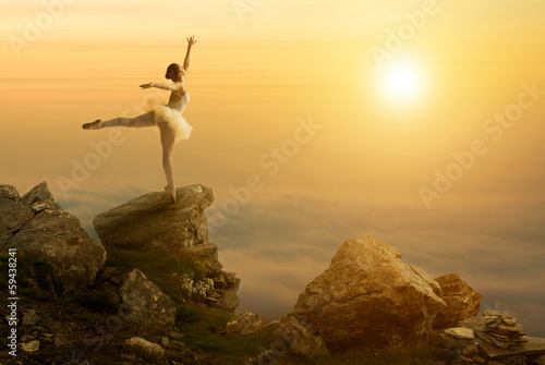 Mystic pictures, ballet dancer stands on the cliff edge - 59438241