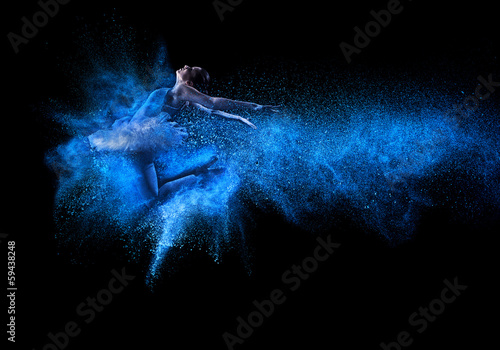 Fotobehang Dans Young beautiful dancer jumping into blue powder cloud