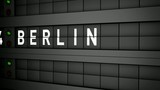 Old airport billboard with city name Berlin