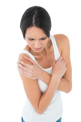 Close-up of a casual woman with shoulder pain