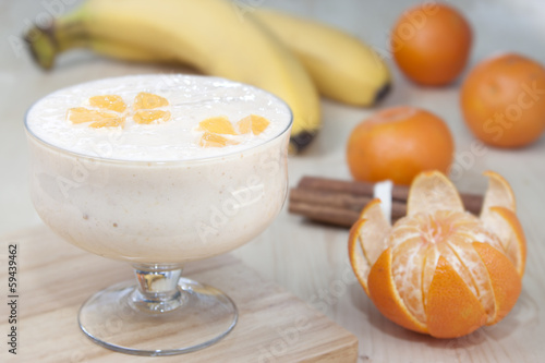 Cocktail of banana with mandarins and yogurt.