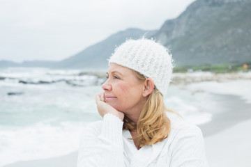 Close-up of contemplative senior woman at beach
