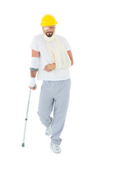 Man in hard hat with broken hand and crutch