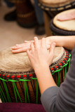 Close up of hands playing a Djembe Drum