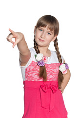 Young girl pointing forward