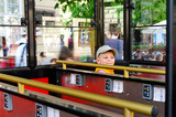 Small boy in a sightseeing tram or coach