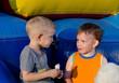 Two cute little boys enjoying cotton candy