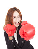 young attractive business woman with boxing gloves