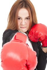angry Businesswoman boxing punching towards and ready to fight