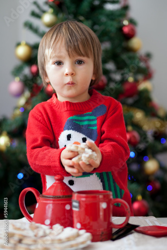Boy, holding christmas cookies