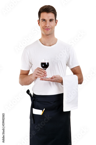 Smiling waiter serving red wine . isolated on white background