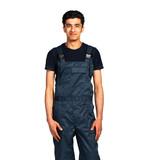 Repairman Arab nationality in the construction overalls on a whi