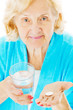 Senior Woman With Water Glass And Tablet