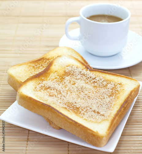 Slice of grilled bread and coffee