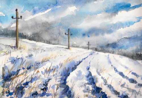 Winter rural landscape with field and dramatic sky