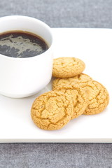 tasty cookies and black coffee