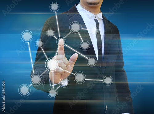 businessman pushing a touch screen interface