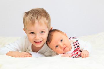 portrait of little boy with newborn sister