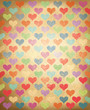 Vector grunge background with colorful hearts pattern.