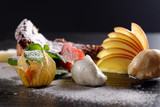 Haute cuisine, dessert on restaurant table, shallow focus depth