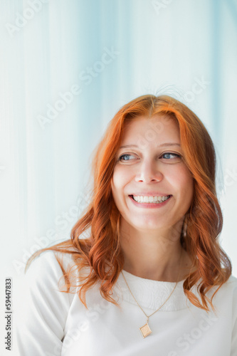 Portrait of smiling red-haired woman