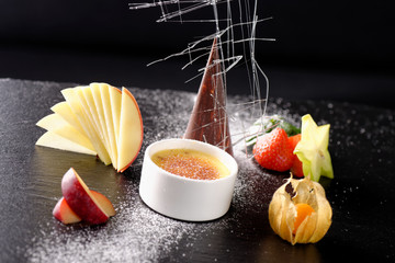 Haute cuisine, dessert Creme brulee and chocolate parfait