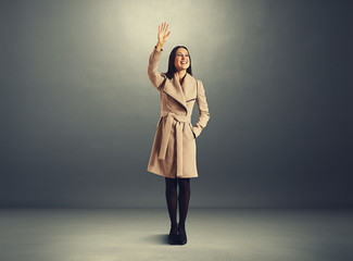 excited young woman waving hand