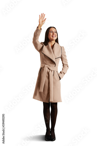 happy young woman waving hand