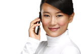 Young smiling asian business woman calling with mobile phone