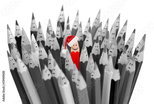 pencil with smile in Santa's Christmas hat among sad gray pencil
