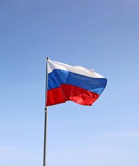 Russian flag waving against a blue sky