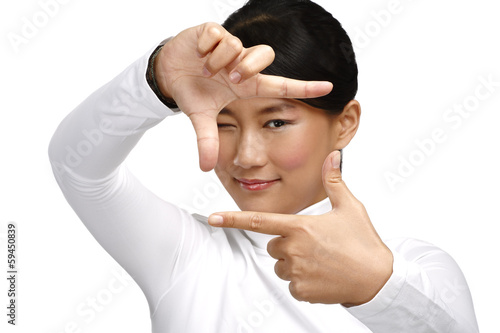 Beautiful asian woman make a frame shot symbol with her hands