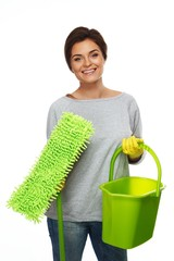 Beautiful cheerful brunette woman in gloves with mop and bucket