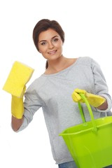 Beautiful  woman in gloves with sponge and bucket