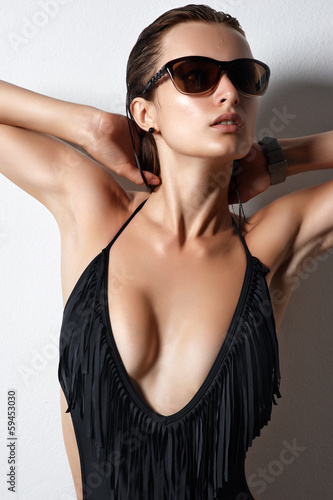 portrait of a sexy girl in sunglasses