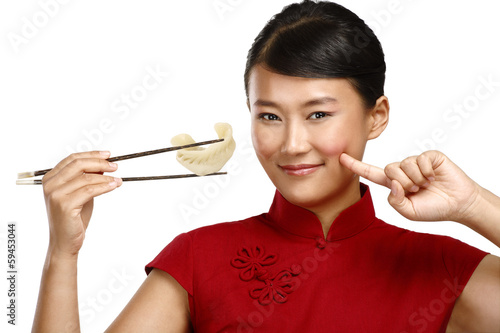 Chinese woman showing asian food using chopstick - 59453044