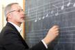 Music teacher writing notes on a blackboard