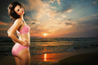 Beautiful woman on the sea beach at sunset