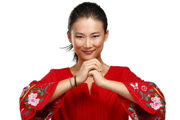 Chinese woman greeting gesture in elegant red dress