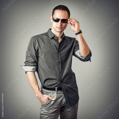young sexy man wearing shirt and sunglasses