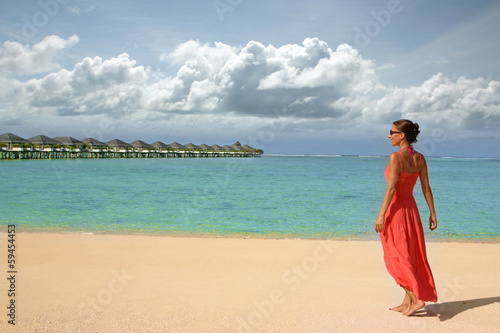 Tropical resort with a girl in a summer dress